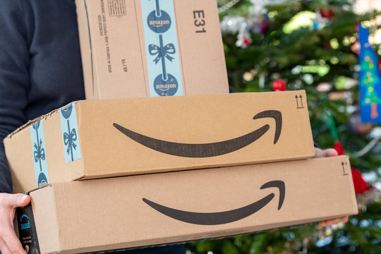 PARIS, FRANCE - DECEMBER 16, 2018: An Amazon Prime package delivered to a residential home for christmas