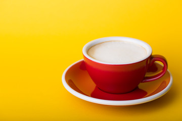 red cup on a  yellow background