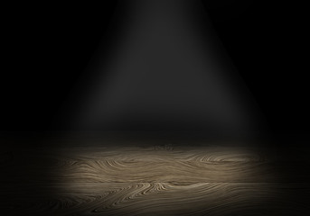 Wooden table on dark background, illuminated from above, free space for your products