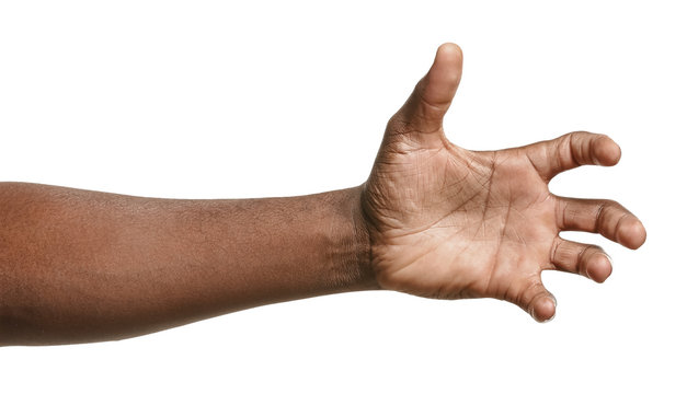Hand of African-American man holding something on white background