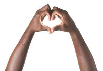 Hand of African-American man showing heart shape on white background