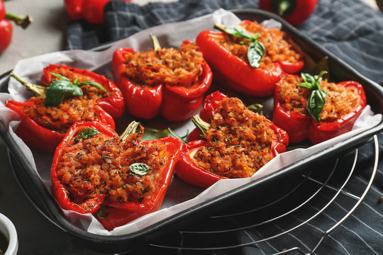 Baking dish with tasty stuffed pepper on table