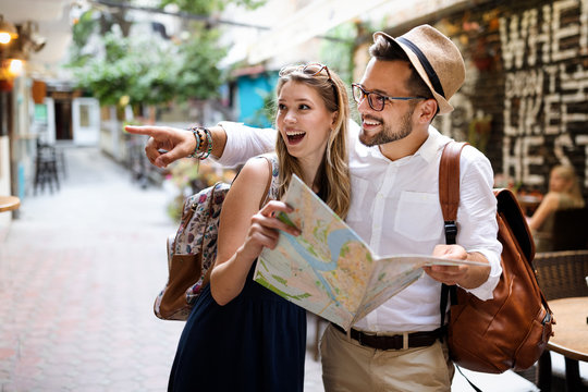 Summer holidays, dating, love and tourism concept. Smiling couple in the city