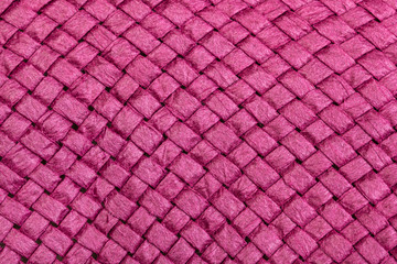 Wall Mural - weaving of straw hat from pink toyo fibers
