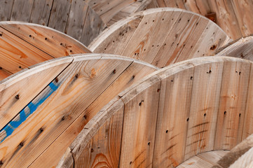 close-up of large wooden cable drums at construction site