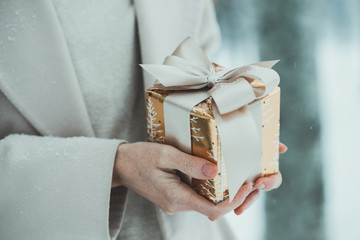 girl holding presents in hands