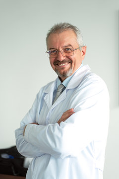 Doctor of medicine, scientist professor standing arms crossed and smiling