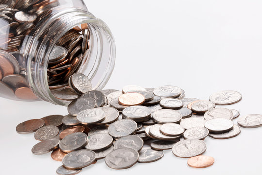 US coins in a jar isolated on white background