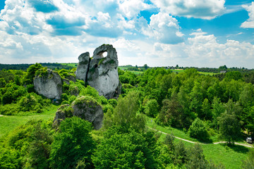 A panoramic view of the unique Okiennik rock in Poland with a large natural window