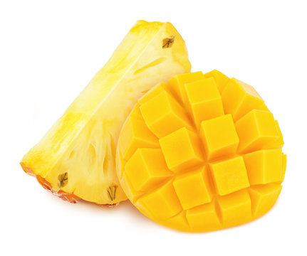 Bright yellow composition with cutted tropical fruits - mango and pineapple isolated on a white background with clipping path.