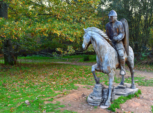 : Carved wooden statue of  Battle of Hastings Soldier on horse back,