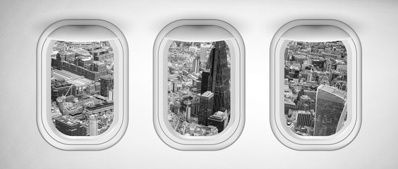 Airplane interior with window view of London City, United Kingdom. Concept of travel and air transportation