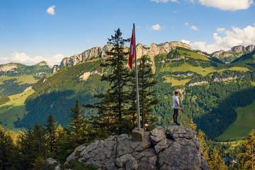 Tourist standing on the Ebenalp mountain in the Swiss Alps of Switzerland