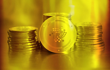 Iota (IOT) digital crypto currency. Stack of golden coins. Cyber money.