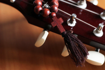 Guitar and wooden cross, music and religion