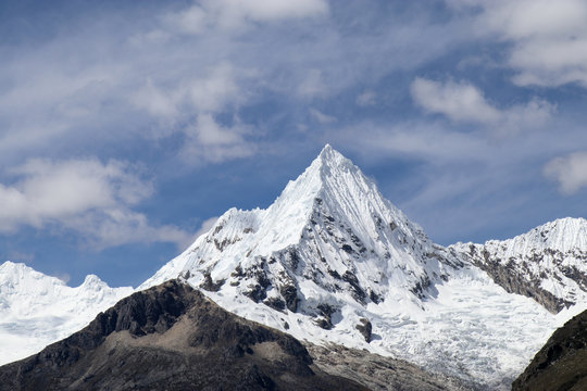 Peru - Hiking around Huaraz to laguna 69 and lake paron in the andes - turquoise blue lakes with snow capped mountains surrounding creating stunning scenery