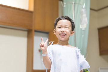 The patient boy is happy in the hospital, He has a cheerful heart.