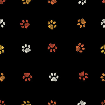Orange, yellow and white doodle paw prints with black background seamless pattern. Happy Halloween background