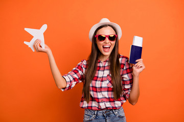 Photo of pretty attractive positive optimistic cheerful glad nice girl waiting to go abroad on plane holding boarding pass in hands isolated bright color background