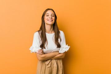 Young caucasian woman laughing and having fun.