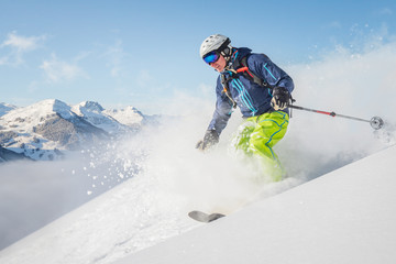 Wall Mural - Male freeride skier in the mountains off-piste