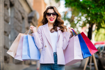 Fototapete - Portrait of her she nice-looking attractive lovely charming pretty fashionable excited cheerful cheery wavy-haired girl holding in hands carrying new things in bags downtown center outdoors