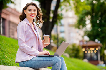 Fototapete - Profile side view portrait of her she nice attractive lovely charming cheerful cheery successful wavy-haired businesslady using laptop wi-fi working remotely on fresh air in park outdoors