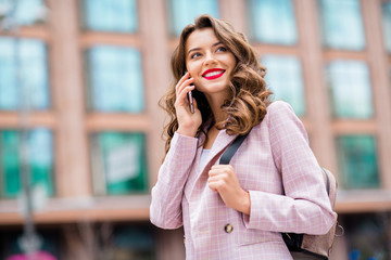 Fototapete - Close-up portrait of nice-looking attractive lovely charming cute winsome shine cheerful cheery wavy-haired lady red lips making call home operator wireless contact in downtown center outdoors