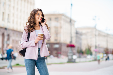 Fototapete - Portrait of her she nice-looking attractive lovely cute cheerful cheery wavy-haired lady foreign tourist making call home discussing adventure landmark sightseeing in downtown center outdoors