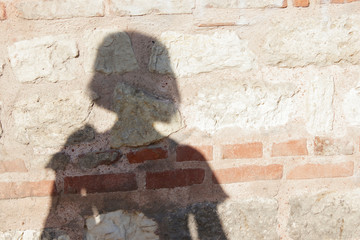 female silhouette on the wall