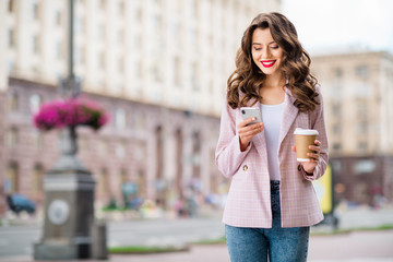 Fototapete - Portrait of her she nice-looking attractive charming lovely cheerful cheery wavy-haired lady stranger using app 5g web service device gadget in downtown center outdoors