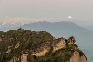 Kalabaka, Greece. Views of an early morning moonset in the mountains of Meteora