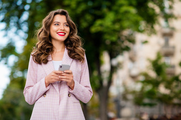 Aufkleber - Portrait of her she nice attractive charming glamorous lovely winsome cheerful cheery dreamy wavy-haired girl traveler tourist using phone in park fresh air outdoors