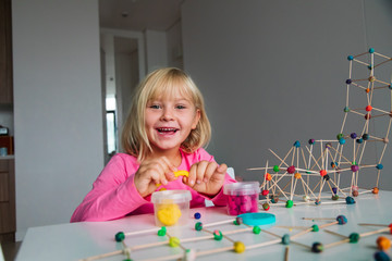 cute girl making geometric shapes from clay, engineering and STEM