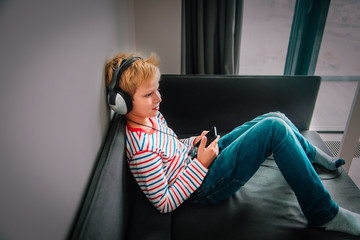teenage boy with headset using mobile phone at home