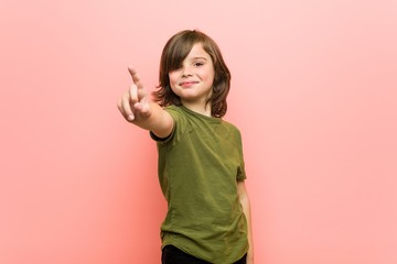 Little boy showing number one with finger.