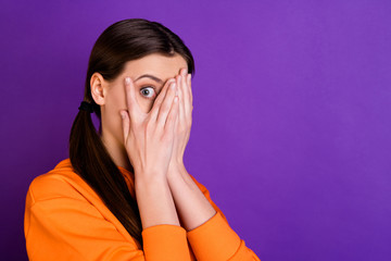 Close up photo of impressed horrified girl close cover hands palms her face eyes feel fear after looking film series wear sportswear isolated over violet purple color background