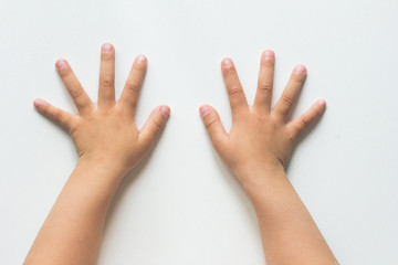 Two hands of child with widespread fingers on the white background