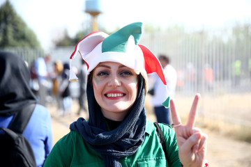 An Iranian woman arrives to watch Iran's World Cup qualifier against Cambodia at the Azadi Stadium in Tehran