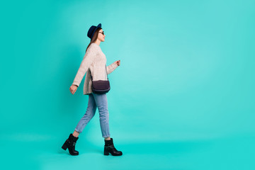 Fototapete - Full length body size view of her she nice-looking attractive lovely charming pretty cute fashionable girl walking isolated over bright vivid shine vibrant color turquoise green background