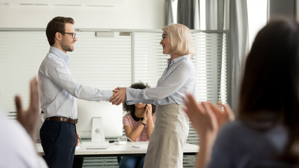 Mature director holding hands of best employee express praising gratitude