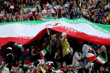 Iranian women fans attend Iran's FIFA World Cup Asian qualifier match against Cambodia, as for the first time women are allowed to watch the national soccer team play in over 40 years, at the Azadi stadium in Tehran