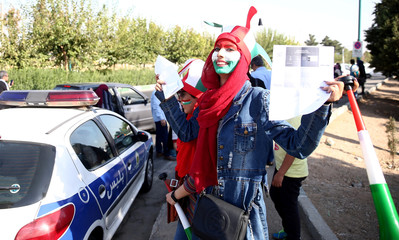 An Iranian fan arrives to attend Iran's FIFA World Cup Asian qualifier match against Cambodia, as for the first time women are allowed to watch the national soccer team play in over 40 years, at the Azadi stadium in Tehran