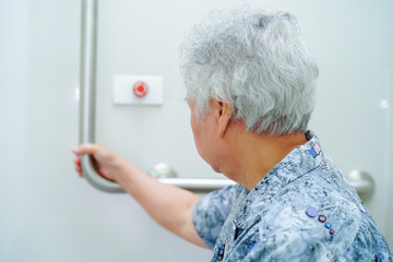 Asian senior or elderly old lady woman patient use toilet bathroom handle security in nursing hospital ward : healthy strong medical concept.  .