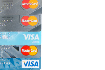 Moscow, Russia - October 10, 2019: Visa and MasterCard credit card on white background. Mastercard and Visa are a biggest credit card companies in the world.