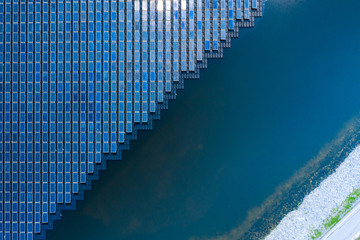 Solar Photovoltaic of solar farm aerial view, solar plant rows array of on the water mount system Installation in earthen pond, water storage Fotoväggar