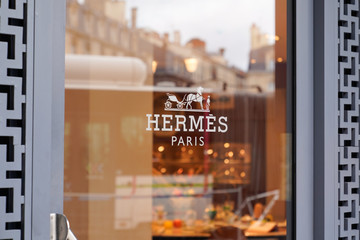 windows door shop sign of Hermes store French manufacturer Hermès store