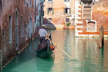 Foto op Canvas Gondolas Venice. Gondolier in the gondola.