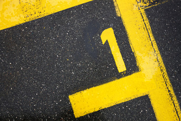 Number one sign on the road, motor race sign on the asphalt, the best pole position, review for the top