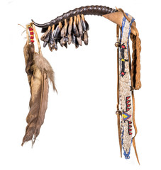 Dance rattle of the North American Indian horn with deer hooves and feathers